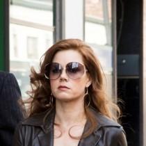 Irving Rosenfeld (Christian Bale), Sydney Prosser (Amy Adams) and Richie Dimaso (Bradley Cooper) walk down Lexington Ave. in Columbia Pictures' AMERICAN HUSTLE. 2013 film still